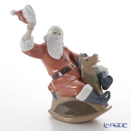 Nao 'What a Fun Ride (Santa Claus Riding Rocking Horse)' 02001677 Christmas Figurine H23cm